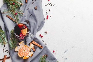 Composition with tasty mulled wine on light background
