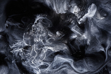 Abstract black and white swirling smoke background. Cumulus thunderclouds, mysterious and frightening sky. Paints colors of depression and negative emotions