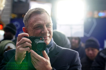 "Actor Daniel Craig holds a Leica camera during a promotional appearance on TV in Times Square for the new James Bond movie ""No Time to Die"" in the Manhattan borough of New York City"