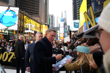 "Actor Daniel Craig signs autographs during a promotional appearance on TV in Times Square for the new James Bond movie ""No Time to Die"" in the Manhattan borough of New York City"