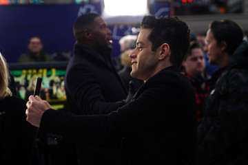 "Actor Rami Malek takes a photo during a promotional appearance on TV in Times Square for the new James Bond movie ""No Time to Die"" in the Manhattan borough of New York City"