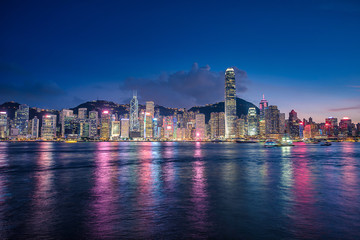 Skyline Hong Kong city at twilight time view from harbor in Hong Kong.