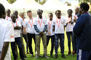 Eliud Kipchoge, the marathon world record holder, stands with others from the Kenyan olympics team as they takes part in a team building exercise during 2019 Athletes Annual Conference in Eldoret