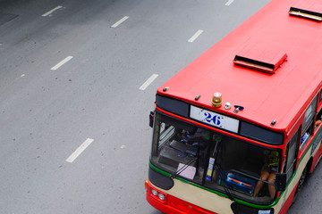 The old red buses in Bangkok are on the road in the lower right corner of the picture