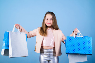 Fashion shop. Little girl with bunch packages. Fashion girl customer. Happy child in shop with bags. Shopping day happiness. Buy clothes. Birthday girl shopping. Fashion boutique. Fashion trend