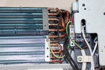 Inverter Air conditioning service, repair & maintenance concept. The specialist cleans and repairs the wall air conditioner. Picture technician cleaning coil cooler of air conditioner