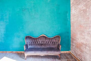 Blue wall interior with sofa. Bright colors design