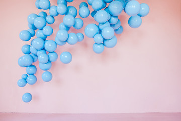 pink wall with blue balloons. Empty space. Background