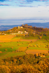 French rural landscape with a castle on a hill in a distance.