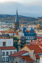 A beautiful view to the roofs and temple tower of Clermont-Ferrand, France