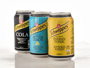Minsk, Belarus - November 20, 2019: Aluminium cans of the Schweppes Bitter Lemon, Indian Tonic and Cola, isolated over white background