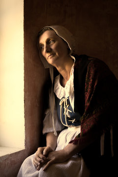 Woman sitting at window in Old Master style