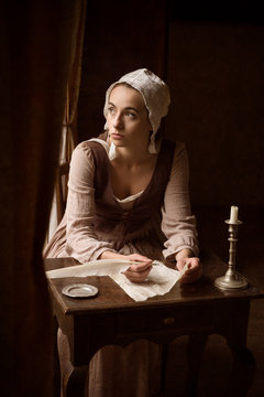 Vermeer style woman with letter