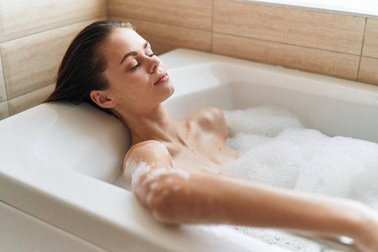 woman in bath with foam