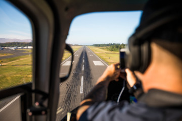 Passenger photographs landing on airport  airstrip