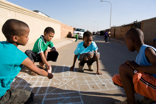 Boys playing on street