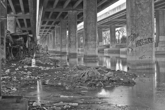 Slum under the overpass viaduct by the sewer system