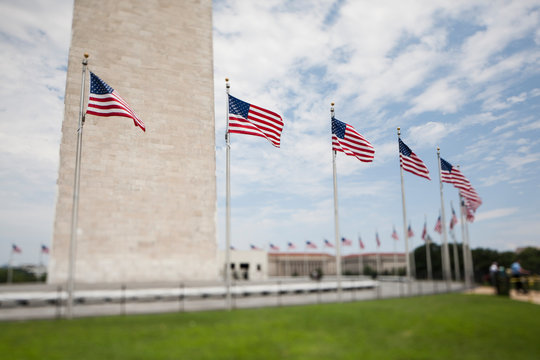 Tilt shift view of flags beneath the Washington Monument in DC.
