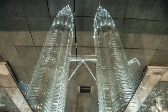 Petronas Tower`s reflection in fountain water