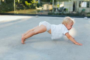 Toddler doing push ups