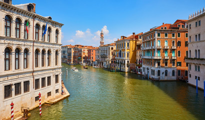 Fototapete - Venice, Italy. Gondolas on Grand Canal among antique buildings and traditional italian Venetian architecture. Sunny day with blue sky and clouds.