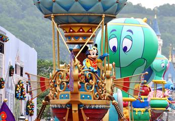 HONG KONG - DEC 2015: Parade in Disneyland with famous cartoon characters in Hong Kong on November 2015 in China