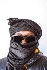 Black person in traditional headscarf