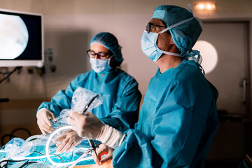 Professional medical team performing surgery in hospital