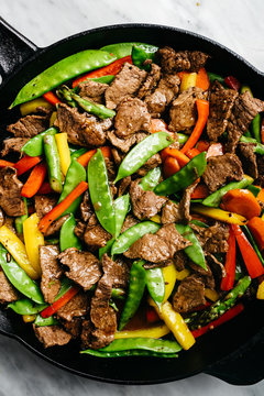 Steak and Veggies stir-fry in an iron skillet