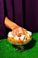 Close up of man's hand grabbing cake
