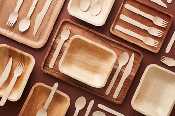 Wooden dishes and cutlery in composition