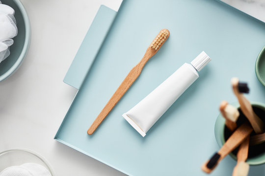 Natural toothbrush with paste tube on tray