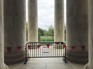 Columns from the Jefferson Memorial, closure barrier in foreground, Washington DC