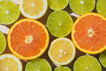 Close up of half tangerine, lemon and lime