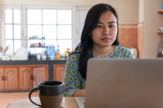 Young asian woman working from home.