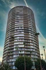 Round Condo Tower in Tropical Sky