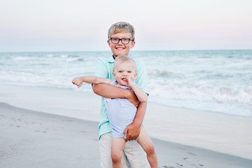 brothers posing for a picture on the beach