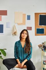 portrait of young designer woman in her studio