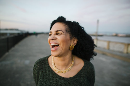 Portrait of mature woman laughing outdoors