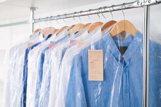 Rack with clothes in modern dry-cleaner's