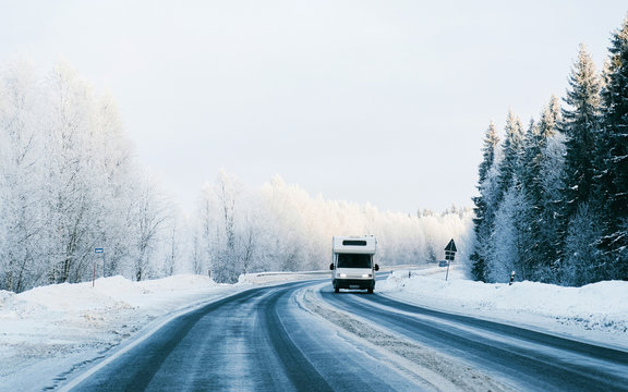 Mini Van on Winter road with snow in Finland. Car and cold landscape of Lapland. Europe forest. Finnish City highway ride. Roadway and route snowy street trip. Driving