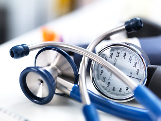 Close-up of sphygmomanometer and stethoscope on table in laboratory