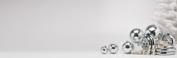 Dumbbell and Christmas ornaments. Fitness New Year and Christmas extra wide screen banner background