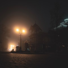 Fototapeten Dunkelbraun Night city in fog, hotel and coffe house. Truskavets, Ukraine.