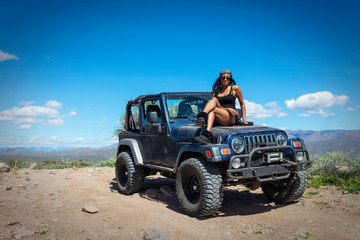 Woman with a jeep in the Arizona Desert