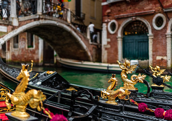 Keuken foto achterwand Gondolas Gondola details with golden seahorse details in Venice, Italy. Traditional gondola on a popular water canal.