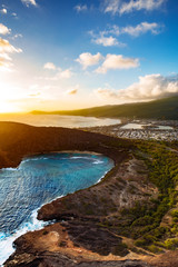 Beautiful nature of Hawaii paradise: mountains, ocean and clods shot from helicopter (aerial pic) at summer sunset time