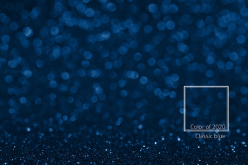 color of the year 2020, shinig sparkles bokeh background. and modern frame of the name of color blue