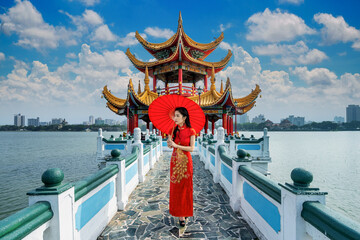 Wall Mural - Asian woman in chinese dress traditional walking at Kaohsiung's famous tourist attractions in Taiwan.