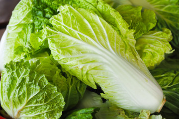 fresh chinese cabbage on wooden table. selective focus